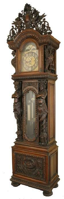 Clock Hourglass Time: A monumental, 10-foot-tall carved oak grandfather , by R. J. Horner, 19th century.