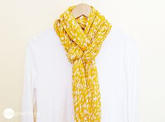 Scarves can instantly add glam to any outfit...any time of the year! Create this easy, but classic, look in seconds!