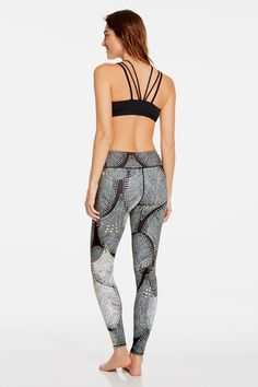 Shine bright in the studio in our holiday Foiled Flurry print leggings and liquid black bra. Wrap up the look in our dance-inspired Rose top that's easy to take on and off pre- and post- workout. | Angelica outfit- Fabletics