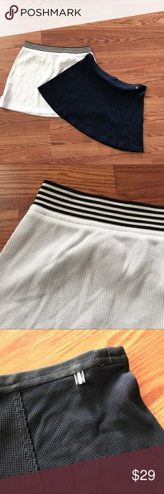 """Two Vintage Tail skirts Tennis Golf size M Two Vintage Tail tennis skirts in size Medium Waffle weave lycra fabric They measure 32/34 inch waist and are 14.5"""" long. Tail Skirts"""