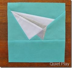 Paper pieced paper plane pattern by Kristy Lea of Quiet Play.