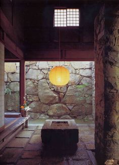 The Izumi House, Takamatsu, Shikoku. A granite house with exposed steel ceiling trusses built by its owner Masatosh Izumi, stonemason, sculptor and close collaborator of sculptor and artist Isamu Noguchi. Allthe stones and boulders were hand-picked over a period of years by Izumi, collected from the Aji quarries. The lanterns are Noguchi's Akari light sculptures, in mulberry paper and bamboo strips.