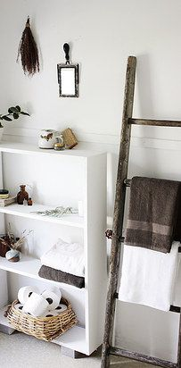 Hang towels on a decorative ladder for a rustic storage option. | 31 Cheap Tricks For Making Your Bathroom The Best Room In The House