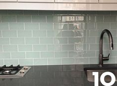 The shiny green backsplash tile goes beautifully with the other finishes in the kitchen and adds just a tiny pop of color to the neutral space.
