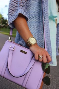Purple/violet handbag with body cross straps or hand hold straps