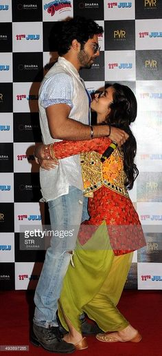 Indian Bollywood film actors Alia Bhatt (R) and Varun Dhawan pose during the trailer launch of their forthcoming Hindi film 'Humpty Sharma Ki Dulhania' directed by debutant Shashank Khaitan and produced by Karan Johar in Mumbai on May 26, 2014.