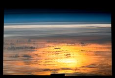 Sunset From the International Space Station Expedition 47 Flight Engineer Jeff Williams of NASA captured a series of photos for this composite image of the setting sun reflected by the ocean. June 16 2016