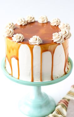 Caramel apple in a cake form? Yes! This soft and fluffy Spiced Apple Cake is paired with salted caramel frosting and topped with smoky salted caramel sauce!!