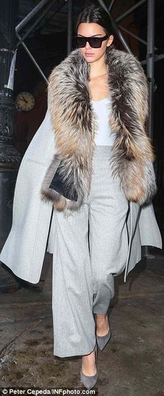 Wrapped up: Kendall was clad in a grey Sally LaPointe wool coat with fur collar and matching wide-leg trousers
