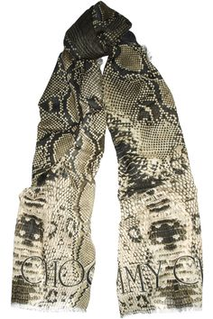 In direct contrast to the new Alexander McQueen scarves.... why did Jimmy Choo have to ruin this otherwise awesome snake-print scarf by plastering his name at the bottom.  lame! $650