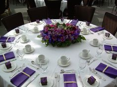 Purple wedding tables - this would be easy to do with paper napkins and an interesting center flower arrangement.