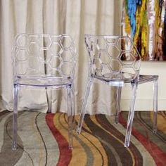 @Overstock - This set of two dining chairs features an attractive, organic shape. These clear chairs are made of durable acrylic in a stackable design.http://www.overstock.com/Home-Garden/Honeycomb-Clear-Acrylic-Modern-Dining-Chair-Set-of-2/5738205/product.html?CID=214117 $297.99