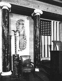 """It is the Roman """"Fasces"""" on the wall behind the Speaker's Podium US House of Representatives chamber, United States Capitol"""