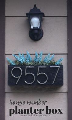 Make a house number planter box to display your address proudly! The front entrance curb appeal of our bilevel home got an upgrade with new exterior lights and a cute house number planter box display! Home Improvement Projects, Home Projects, Decoration Entree, Farmhouse Side Table, Cute House, Pallet Lounge, Front Entrances, Exterior Lighting, Planter Boxes