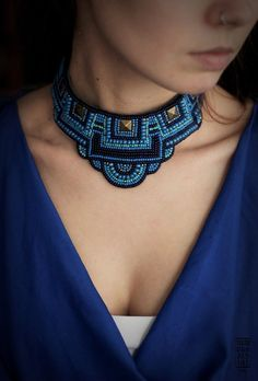 A hand embroidered necklace <3 Made with love. Ties on a ribbon, suits thin neck. The backing is made of blue leather Shipping worldwide Shipping 6$