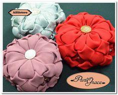 Pequeños almohadoncitos o alfileteros artesanales Punto Grace realizados en capitoné y bordados a mano. Modelos exclusivos en diversidad de colores.