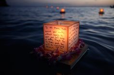 Floating lanterns in tribute to those who served their country Funeral Memorial, Memorial Day, Floating Lanterns, Memorial Flowers, Home Of The Brave, Rose Of Sharon, Life Pictures, Personalized Wedding, Pillar Candles
