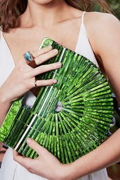 Cult Gaia used Lucite® acrylic to create this clutch, the Malachite Ark.