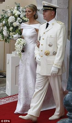 Prince Albert II of Monaco and Charlene Wittstock wedding.Gorgeous bead work, beautiful design. He's not bad either;-)