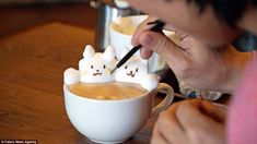 The daily grind: While most of us prefer to guzzle our morning coffee, one clever Japanese barista is turning lattes into works of art