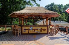 Tiki Bar with swing stools by Core Outdoor Living