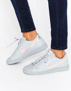 separation shoes a7dba fc5ff Nike   Zapatillas de deporte clásicas grises con detalle de holograma de  Nike en ASOS Nike
