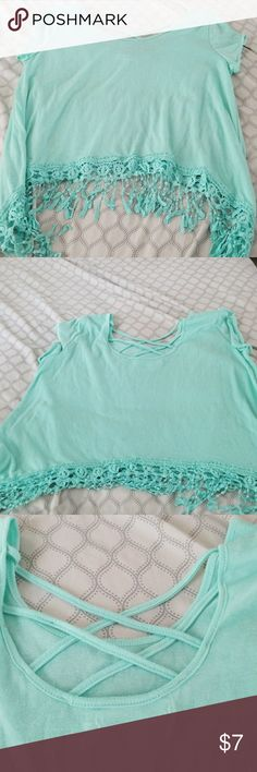 Teal cropped shirt Cropped tee with lacey bottom accents and a cutout cross back. Roomates Tops Crop Tops