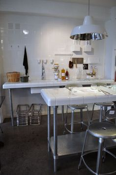 Love the dinning table. White tall dinning table tile table industry white lamp paris