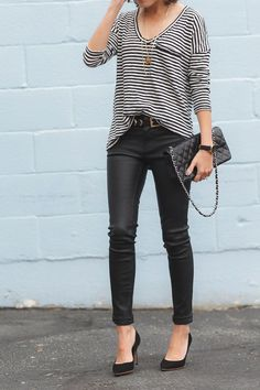 Black leather pants and a striped shirt