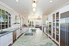 Glass cabinetry.  Ocean Home | A Behind-the-Scenes Look at Kym Gold's Malibu Beach House
