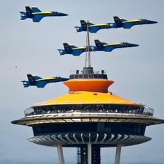 The Blue Angels over the Space Needle.  The Needle is painted orange, its original 1962 color, in honor of the 50th anniversary of the Seattle World's Fair.