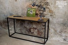 Console made of recycled elmwood with an iron base