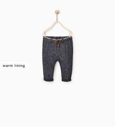 Image 1 of Lined herringbone trousers from Zara