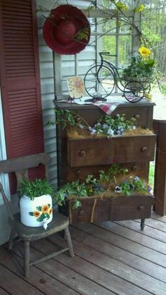 """This picture was pinned to a """"Porch"""" board...BUT...I thought the plants in the drawer idea would also look nice in a yard or on a backyard patio.  Thus, it's repined on my Gardening board."""