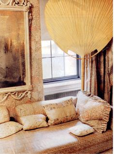 Beautifully upholstered sofa in Nan Kempner's dressing room. Photography by Fernando Bengoechea.