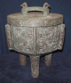 TIKI BAR TOP ICE BUCKET. BY JAMES MONT. SOME PAINT FINISH LOSS TO THE TOP OF LID…