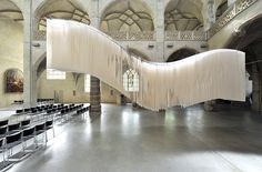 Depth is not a concept immediately sparked when we think of thin pieces of paper, however artist Angela Glajcar gives the typically 2D medium a new sculptural life—stringing together dozens of sheets to create cavernous works often lit from their core. The trailing sculptures are ripped haphazardly