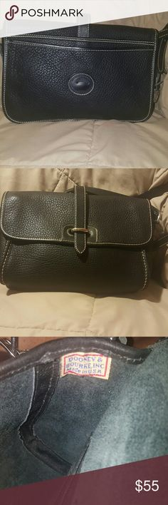 Dooney & Bourke black all weather leather handbag In excellent condition  Signs of wear inside as shown. Black all weather leather Dooney & Bourke Bags