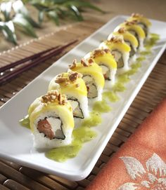 Yellow Monkey Roll (RA Sushi) - Mango, roasted red pepper, marinated artichoke & cream cheese rolled in rice & seaweed, topped with mango & cashews; drizzled with a kiwi wasabi sauce