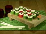 Kids Mock Suchi : Fruit-Roll-Ups & Rice Crispy Bar Filling, a Gummy Worm in the middle ...April Fools :)