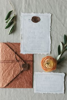 Vintage inspired wedding invitations in light grey on magnolia paper with copper antler seals and leather-like envelopes. See more here: http://www.tuktupaperco.com