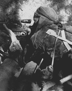 Private L.V. Hughes, 48th Highlanders of Canada, sniping German position 1944. Foglia River, Italy