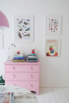whitewashed wood floors and pink dresser, perfect for a little girl's room.