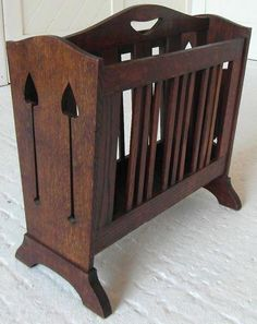 Saved by Claire DeVore, shared 562 times. Liberty & Co. Arts & Crafts magazine rack while human size it is an inspiration! Could be fun to upgrade some horrid Concord miniature Arts And Crafts Furniture, Arts And Crafts House, Home Crafts, Diy Home Decor, Craftsman Style Furniture, Mission Style Furniture, Arts And Crafts Movement, Wood Projects, Woodworking Projects