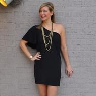 long necklace with one shoulder dress