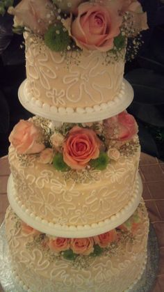 Sometimes pillars are killer.  They let you put more flowers on your cake. $200 for this cake.
