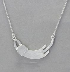 Two Stupid Cats ~ Products ~ Elegant Sterling Silver Stretching Cat Necklace   Elegant and simple sterling silver necklace - Let Kitty hang around your neck. Buy Elegant Sterling Silver Stretching Cat Necklace for yourself or as a gift.