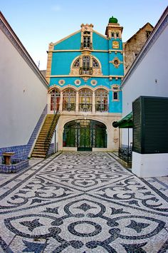 Aveiro, Portugal - art deco house with traditional cobblestone courtyard Places Around The World, The Places Youll Go, Around The Worlds, Oh The Places You'll Go, Algarve, Portugal Travel, Spain And Portugal, Beautiful Buildings, Beautiful Places