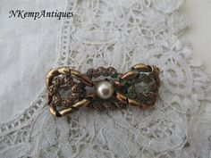 1930's bow brooch by Nkempantiques on Etsy