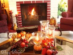put acorns in the bottom of the tall glass vase, suspend a thinner one inside with a candle